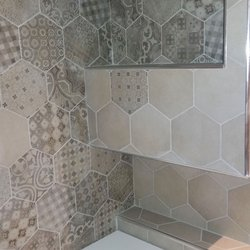 Cement tiles renovate an antique bathroom in Bari