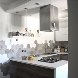 Rewind cement tiles star in a kitchen in Latina