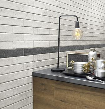 A white, modern kitchen: an evergreen with Ragno ceramic tiles
